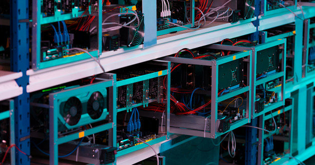 Graphics cards on a shelf at a cryptocurrency mining farm: crypto-mining malware