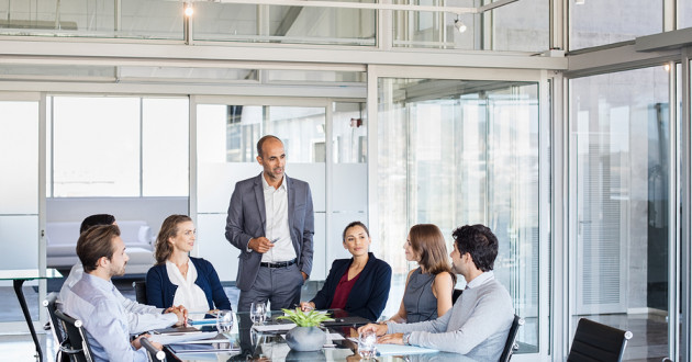 A team meets in the conference room of a modern office: ISO 31000:2018