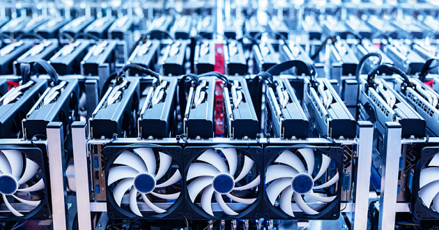 Rows of cryptocurrency-mining hardware: cryptojacking