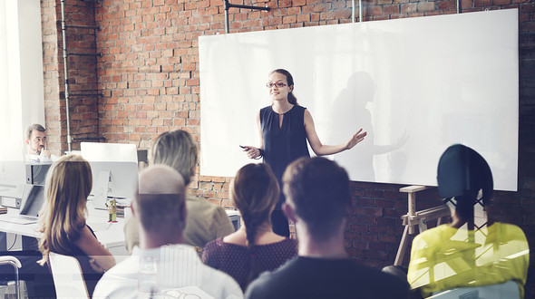 A leader giving a presentation to her company: articulate leader