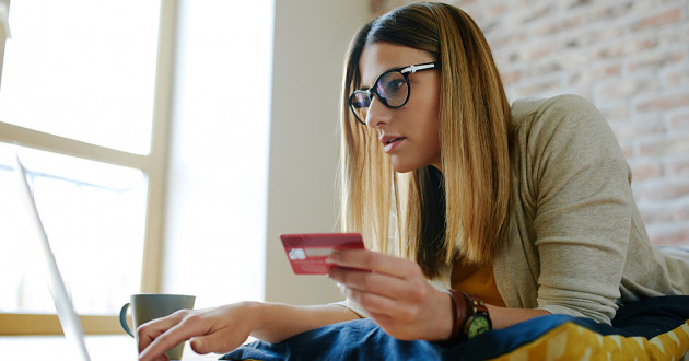 A woman submitting credit card information to a website: third-party access