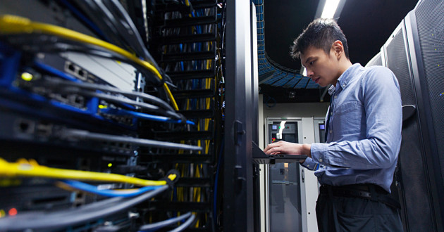 A young IT engineer working in a data center: data classification