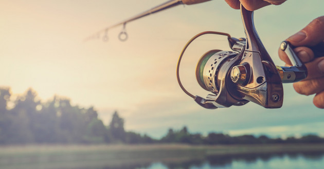 Man reeling in a fish at a lake: email security best practices