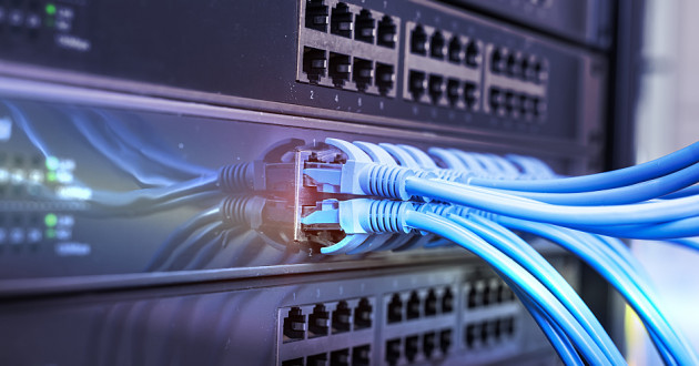 Blue cable plugged into a router: router attack