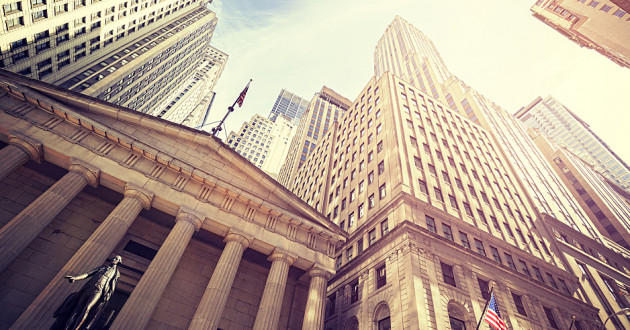 Upward view of skyscrapers and financial institutions on Wall Street: IQY files
