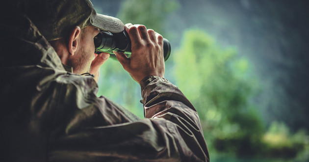 A hunter looks through binoculars: cyberthreat hunting