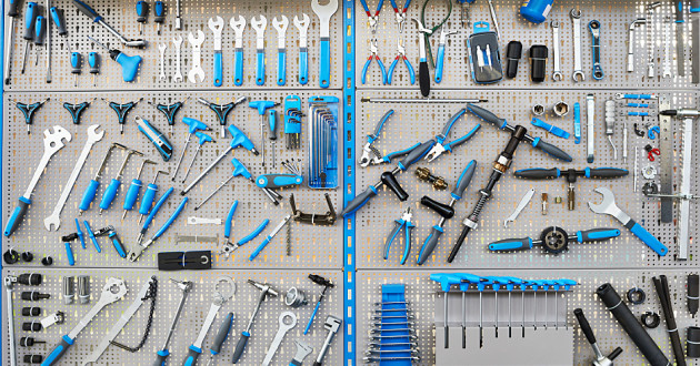 Various tools on a blue tool bench: security tools