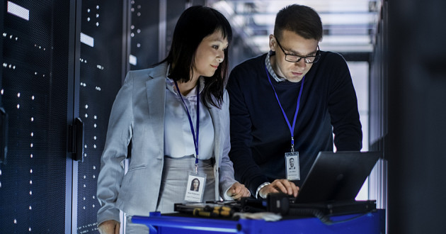 Two IT professionals working as part of a managed IAM service team.