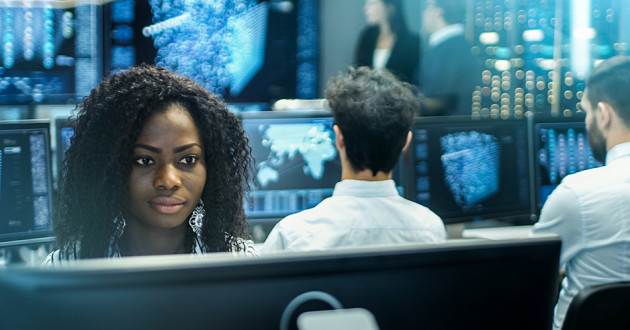 An analyst monitoring threat intelligence in a security operations center (SOC).