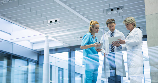 Healthcare professionals reviewing data on a digital tablet: AI in healthcare