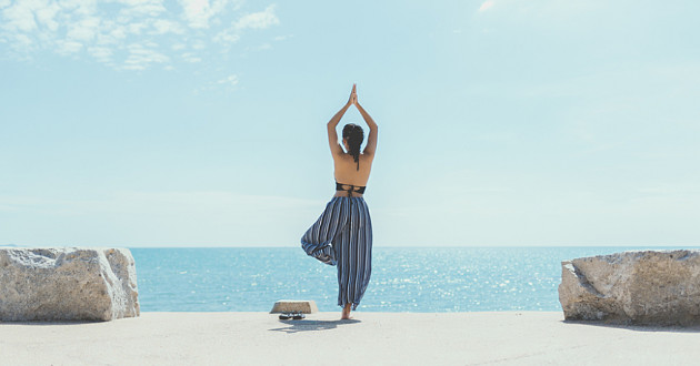 A person practicing yoga on a beach: cybersecurity strategy