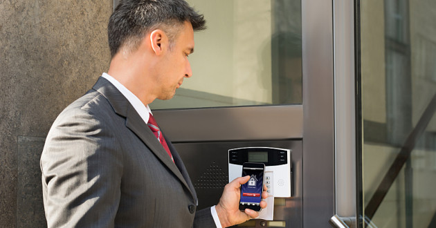 A businessman using a mobile phone for  stout authentication.