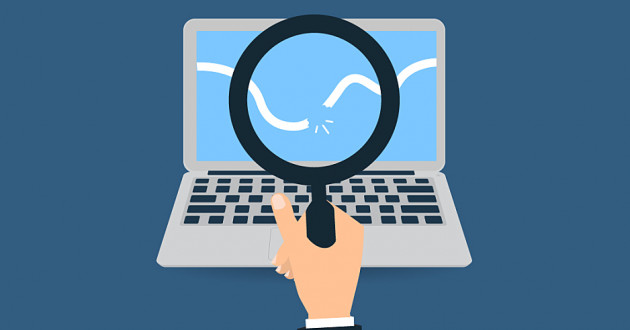 A hand holding a magnifying glass over a computer screen: how to detect a  transgression in your network