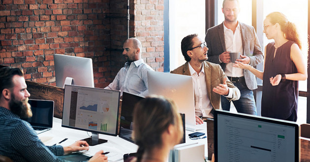 Security professionals conversing in a modern office: lessons for CISOs