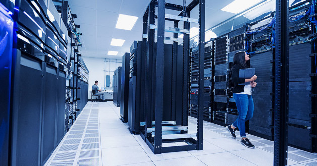 IT professionals working in a data center: cloud adoption