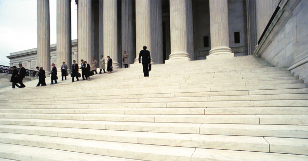 Professionals on the steps of a government building: Cannon Trojan