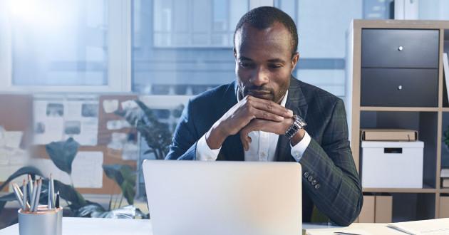 A businessman using a laptop: remote access Trojan