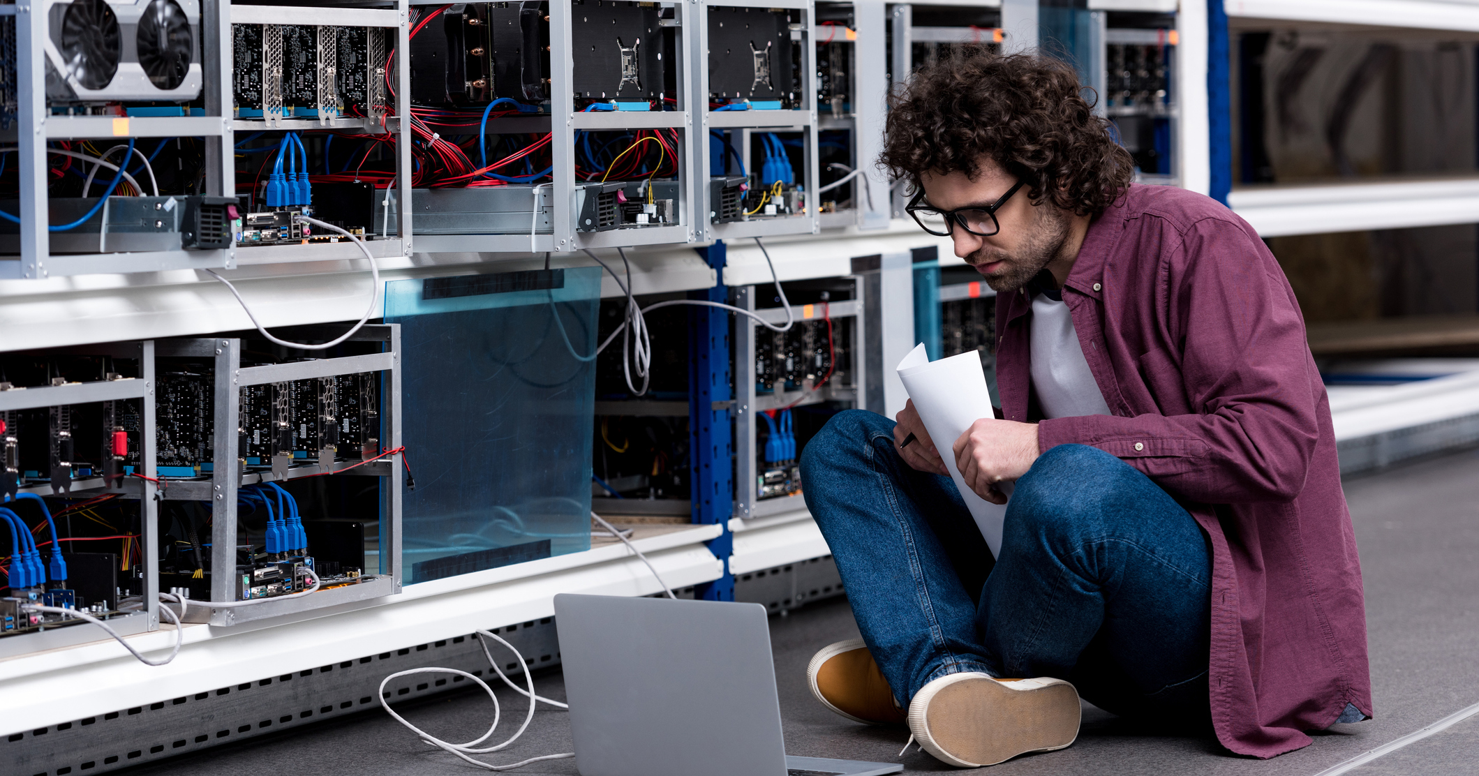 A man mining cryptocurrency.