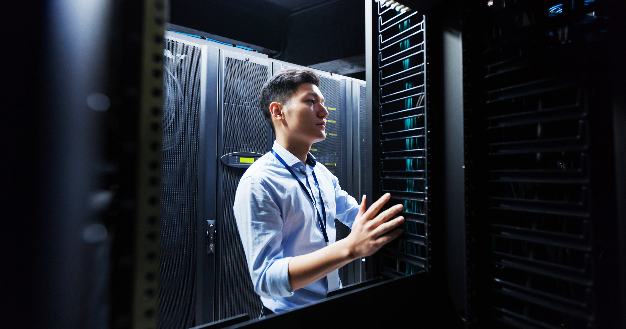 IT engineer working in a server room: data risk