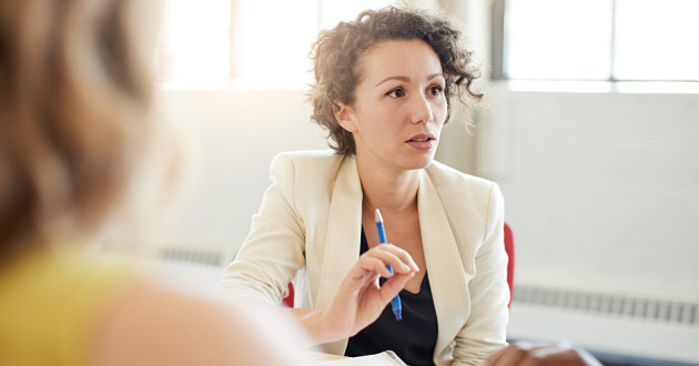 A businesswoman discussing the organization's security program in a business meeting.