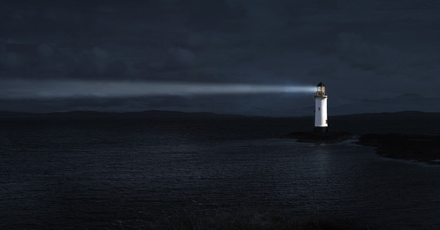 Lighthouse shines across water at night: security predictions