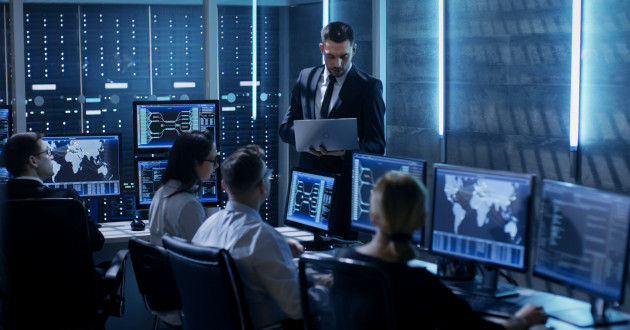 Analysts working on a cyber deterrence strategy in a security operations center.