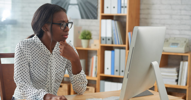 A businesswoman checking her email: spam campaign