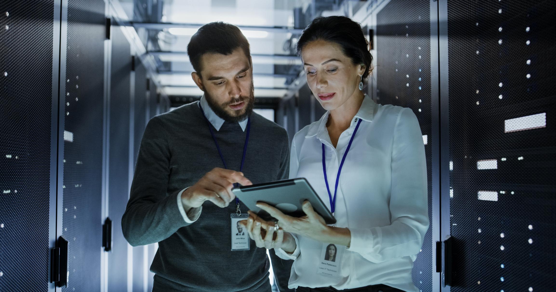 IT engineers mitigating cyber risks in server room