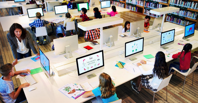 Children using computers in a classroom: EdTech