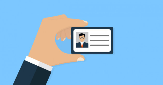 Illustration of a hand holding an identification card: identity and access management