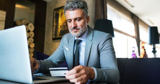 Businessman Using Laptop At Risk Of Banking Trojan