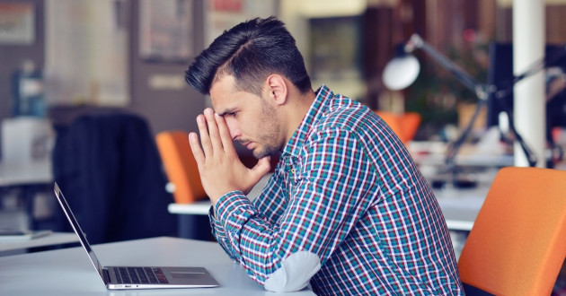 Man working on a computer looking distraught: VFEmail