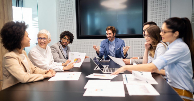 Business colleagues working on a customer-first strategy in a meeting room.